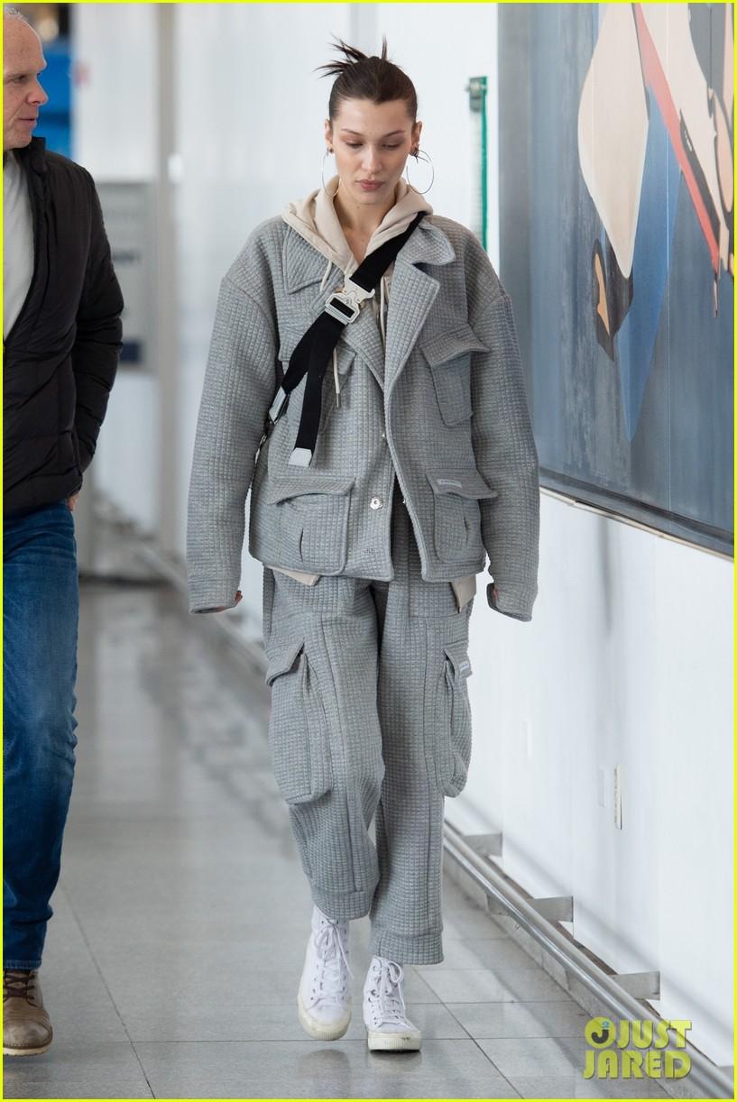 bella hadid bundles up in comfy grey suit while landing in nyc 05