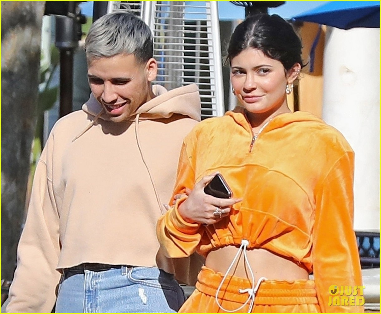 kylie jenner sports orange track suit for lunch at sugar fish 024262805