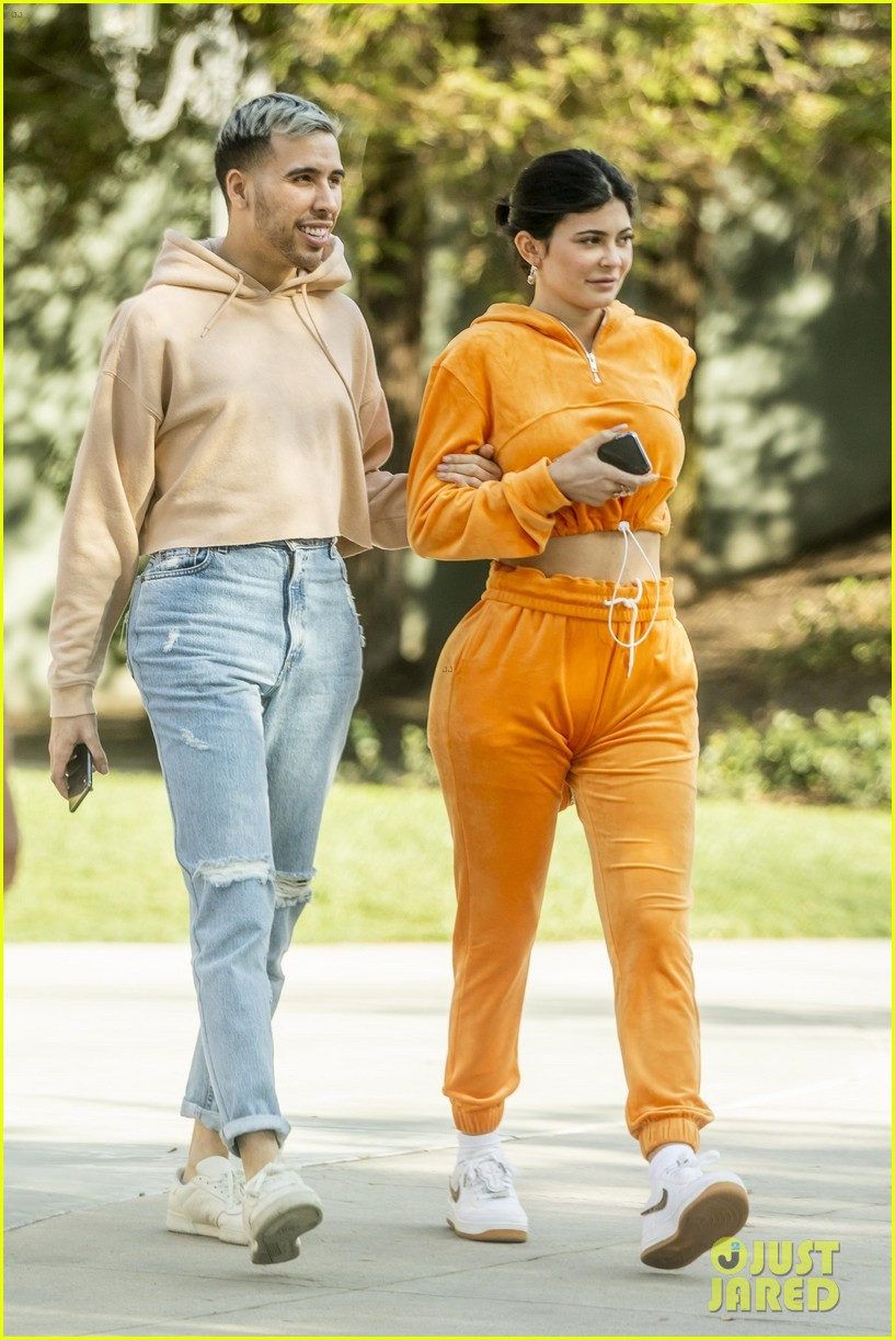 kylie jenner sports orange track suit for lunch at sugar fish 034262806