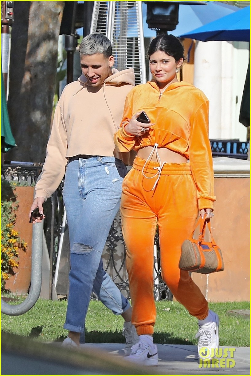 kylie jenner sports orange track suit for lunch at sugar fish 05