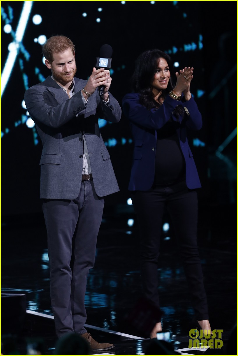 prince harry drags duchess meghan markle on stage we day 01