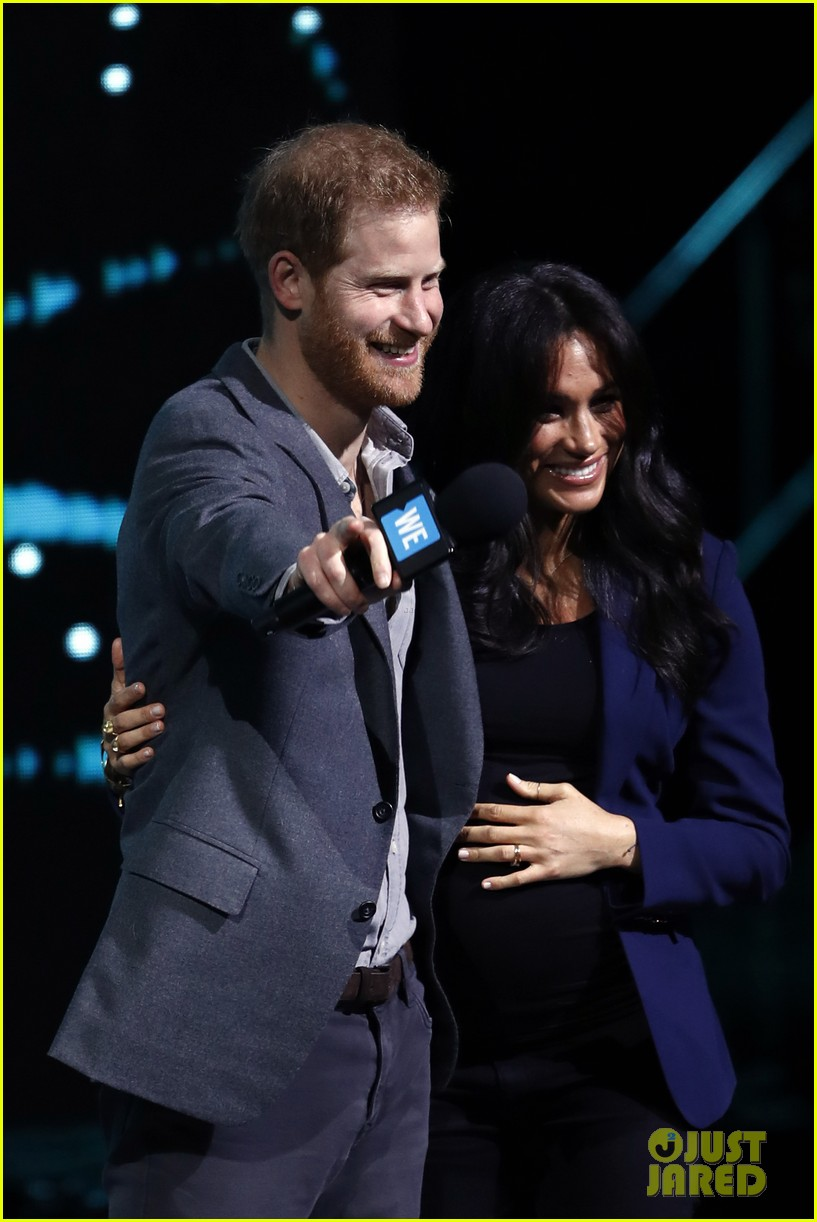 prince harry drags duchess meghan markle on stage we day 02