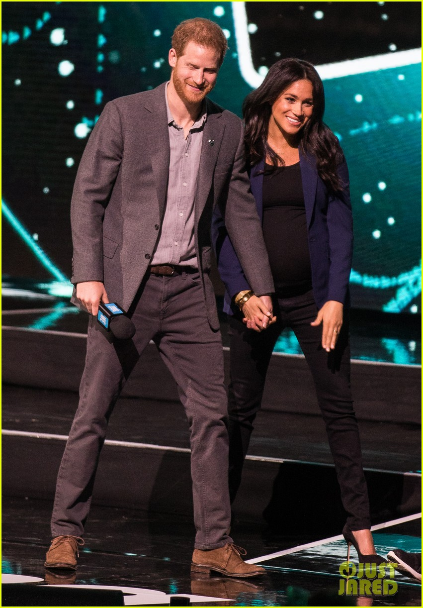 prince harry drags duchess meghan markle on stage we day 03