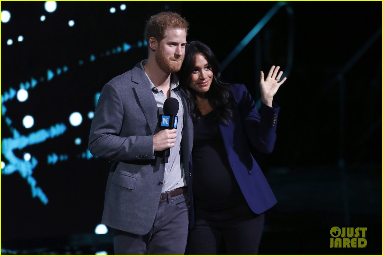 prince harry drags duchess meghan markle on stage we day 05
