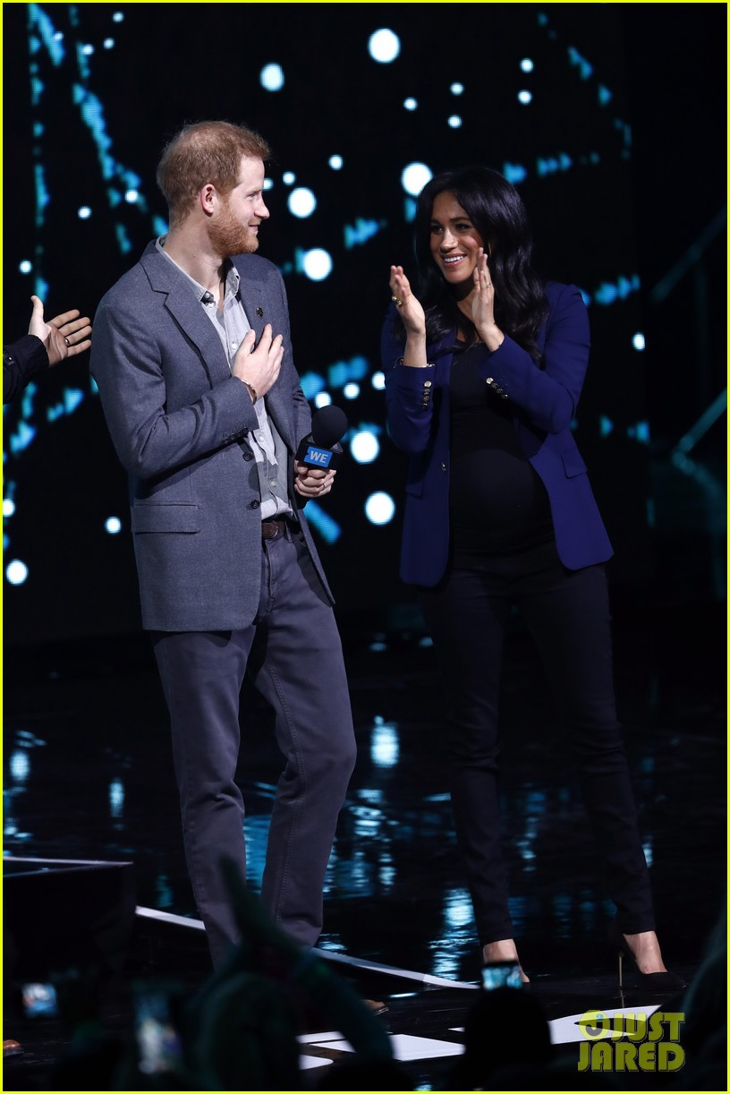 prince harry drags duchess meghan markle on stage we day 06
