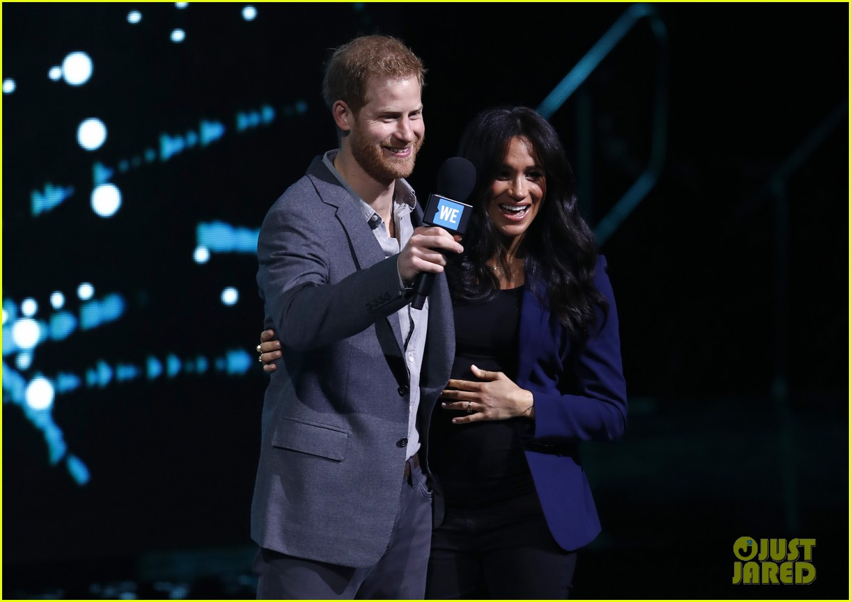 prince harry drags duchess meghan markle on stage we day 11