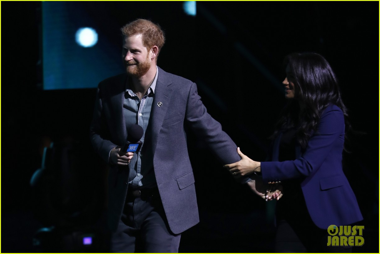 prince harry drags duchess meghan markle on stage we day 12