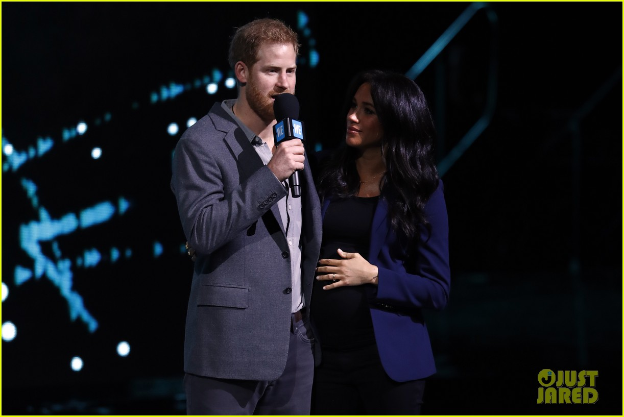 prince harry drags duchess meghan markle on stage we day 13