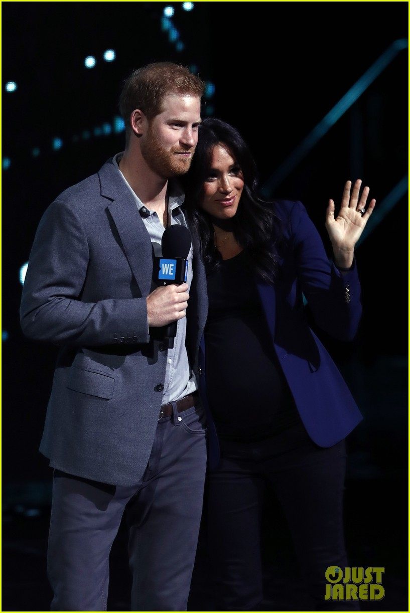 prince harry drags duchess meghan markle on stage we day 14