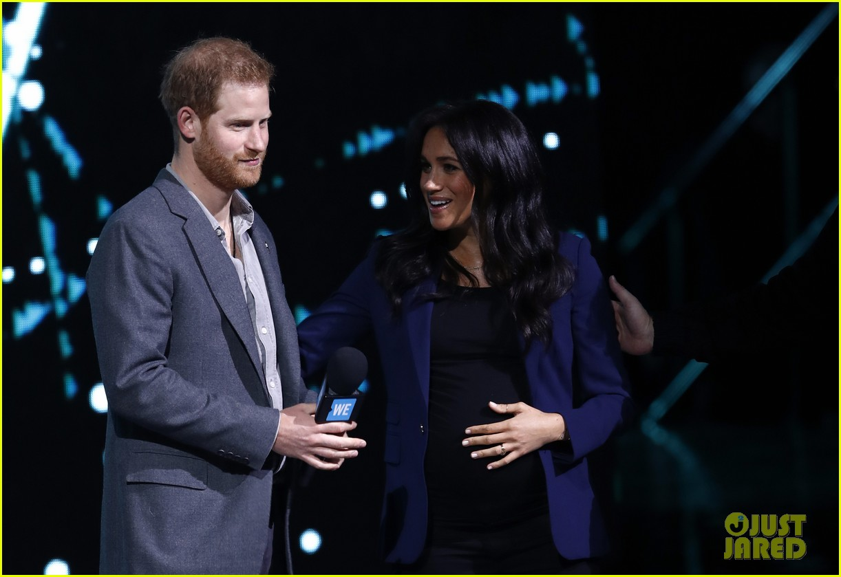 prince harry drags duchess meghan markle on stage we day 16