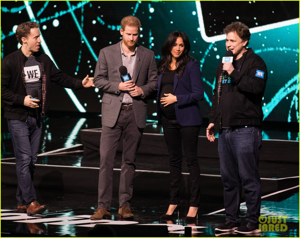 prince harry drags duchess meghan markle on stage we day 19