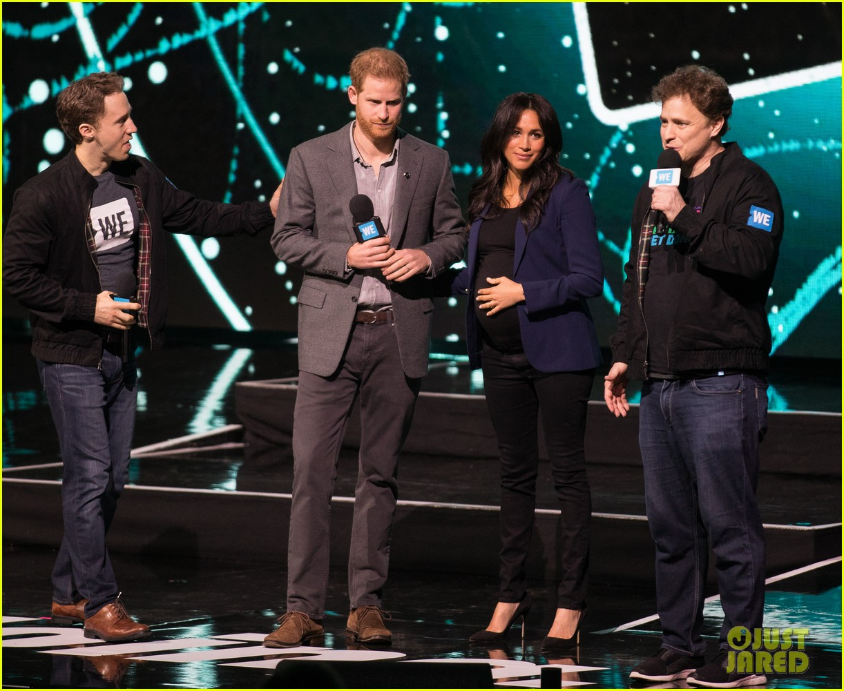 prince harry drags duchess meghan markle on stage we day 20