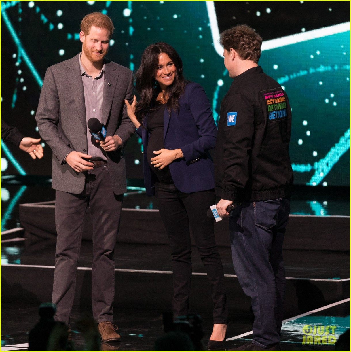 prince harry drags duchess meghan markle on stage we day 23