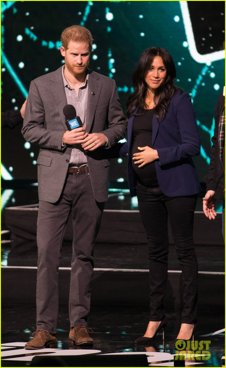 prince harry drags duchess meghan markle on stage we day 24