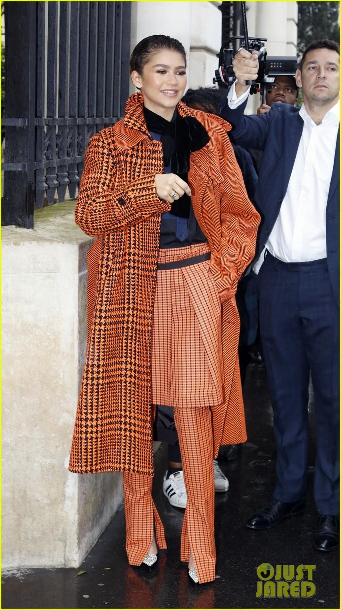 Zendaya Pops In Orange While Out During Paris Fashion Week Photo