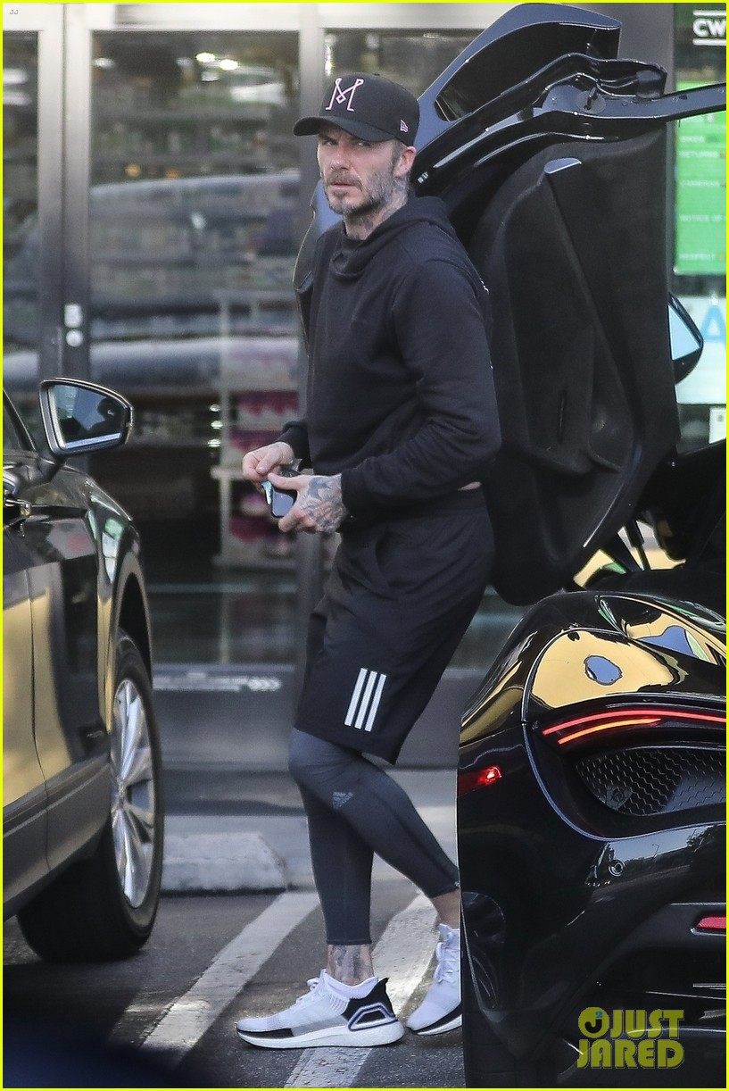 David Beckham Shows Off His Sports Car While Getting In A