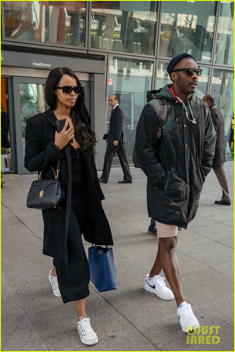 idris elba and fiancee sabrina dhowre land in london after coachella 03