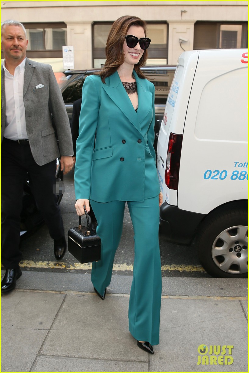 anne hathaway puts fun spin on traditional suit look 154274493