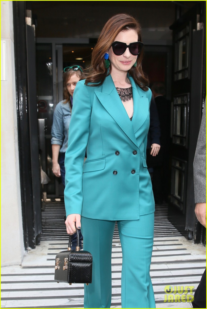 anne hathaway puts fun spin on traditional suit look 244274502