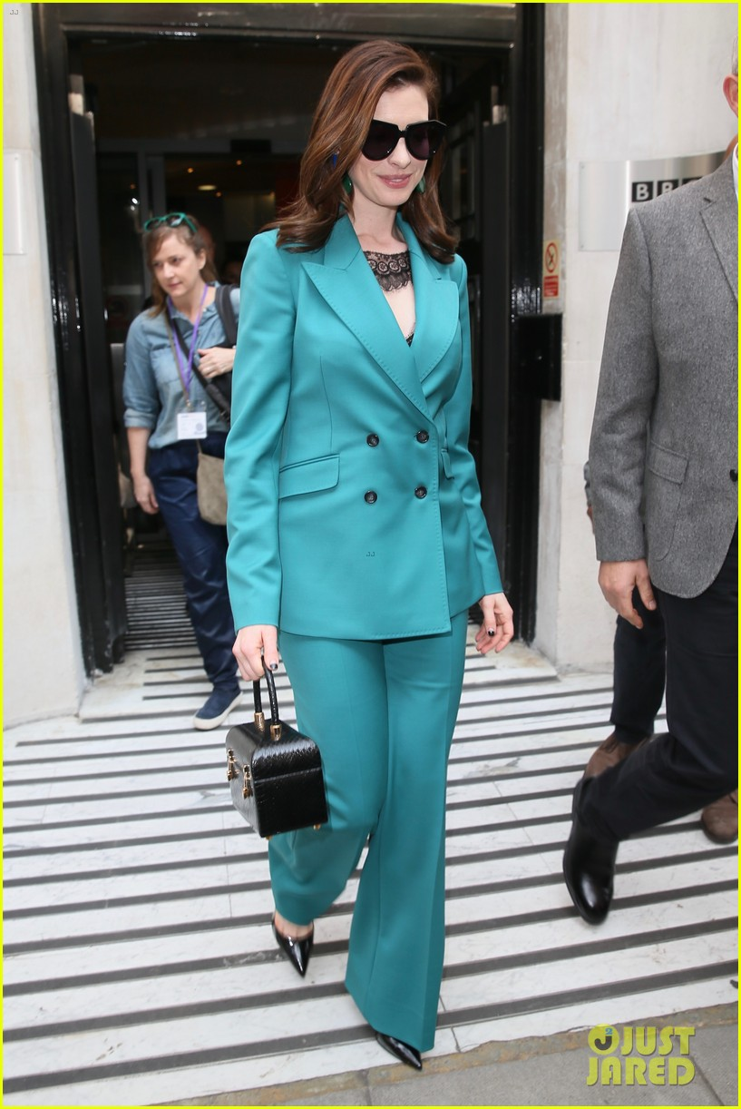 anne hathaway puts fun spin on traditional suit look 254274503