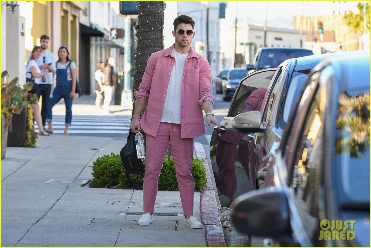 Nick Jonas Rocks A Pink Outfit While Shopping On Rodeo