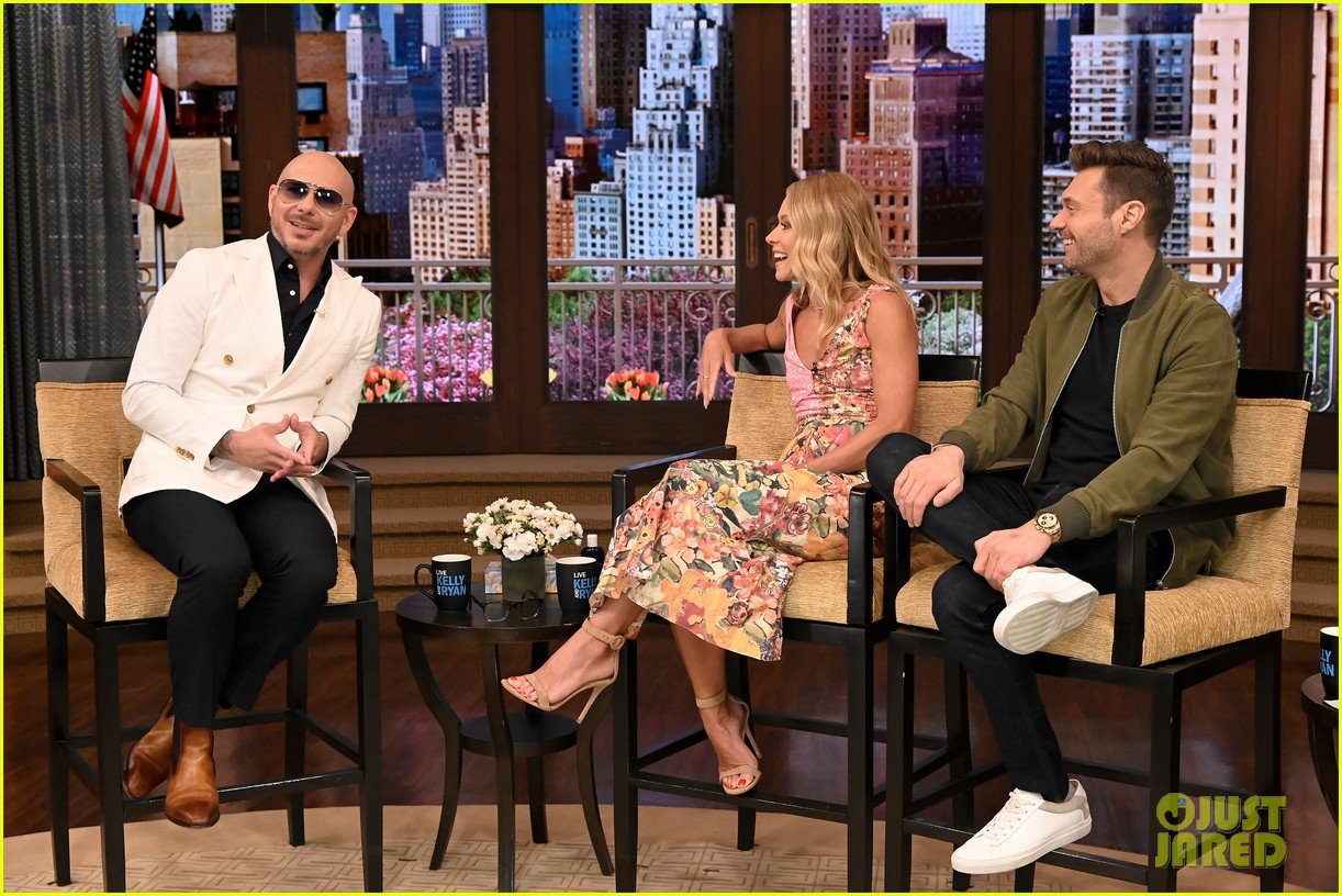 pitbull says he inspired john travolta to shave his head 01