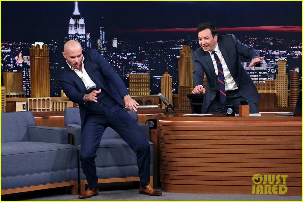pitbull says he inspired john travolta to shave his head 02