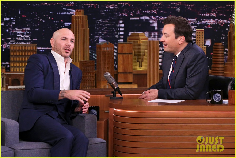 pitbull says he inspired john travolta to shave his head 03