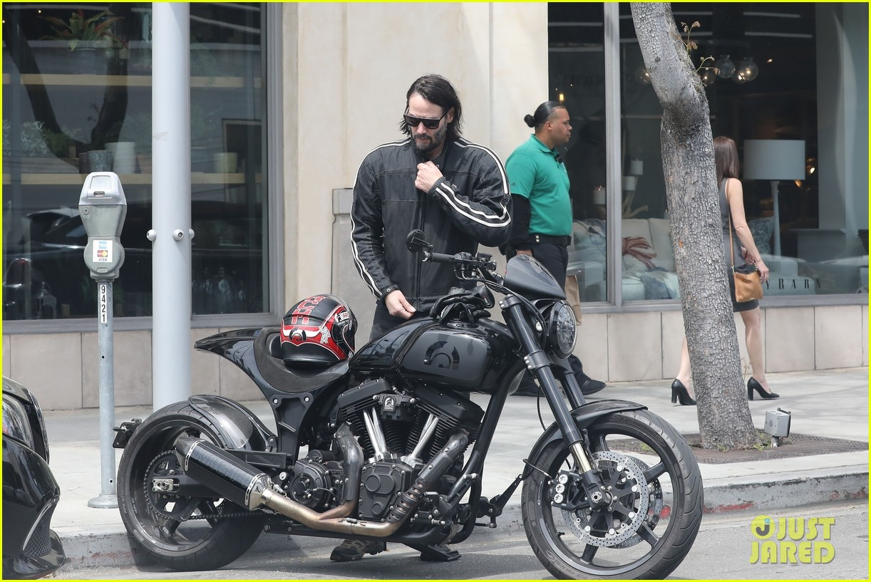 keanu reeves hops on his motorcycle after lunch meeting 01