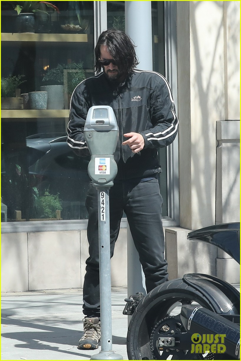 keanu reeves hops on his motorcycle after lunch meeting 02