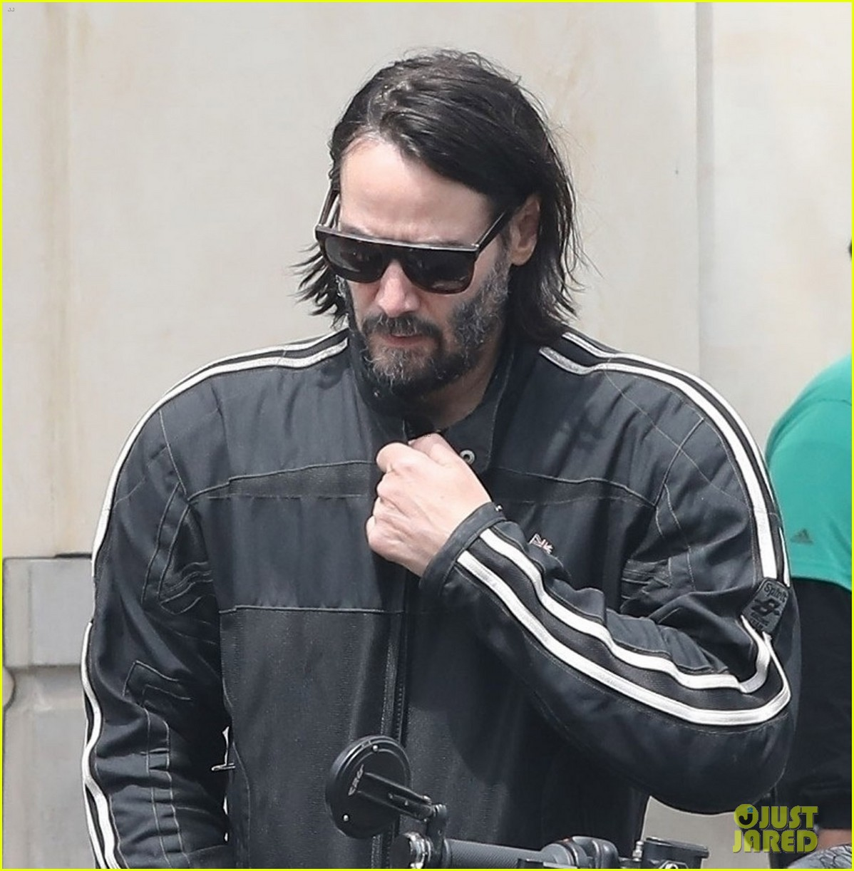 keanu reeves hops on his motorcycle after lunch meeting 03