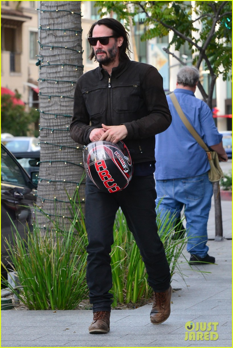 keanu reeves hops on his motorcycle after lunch meeting 04
