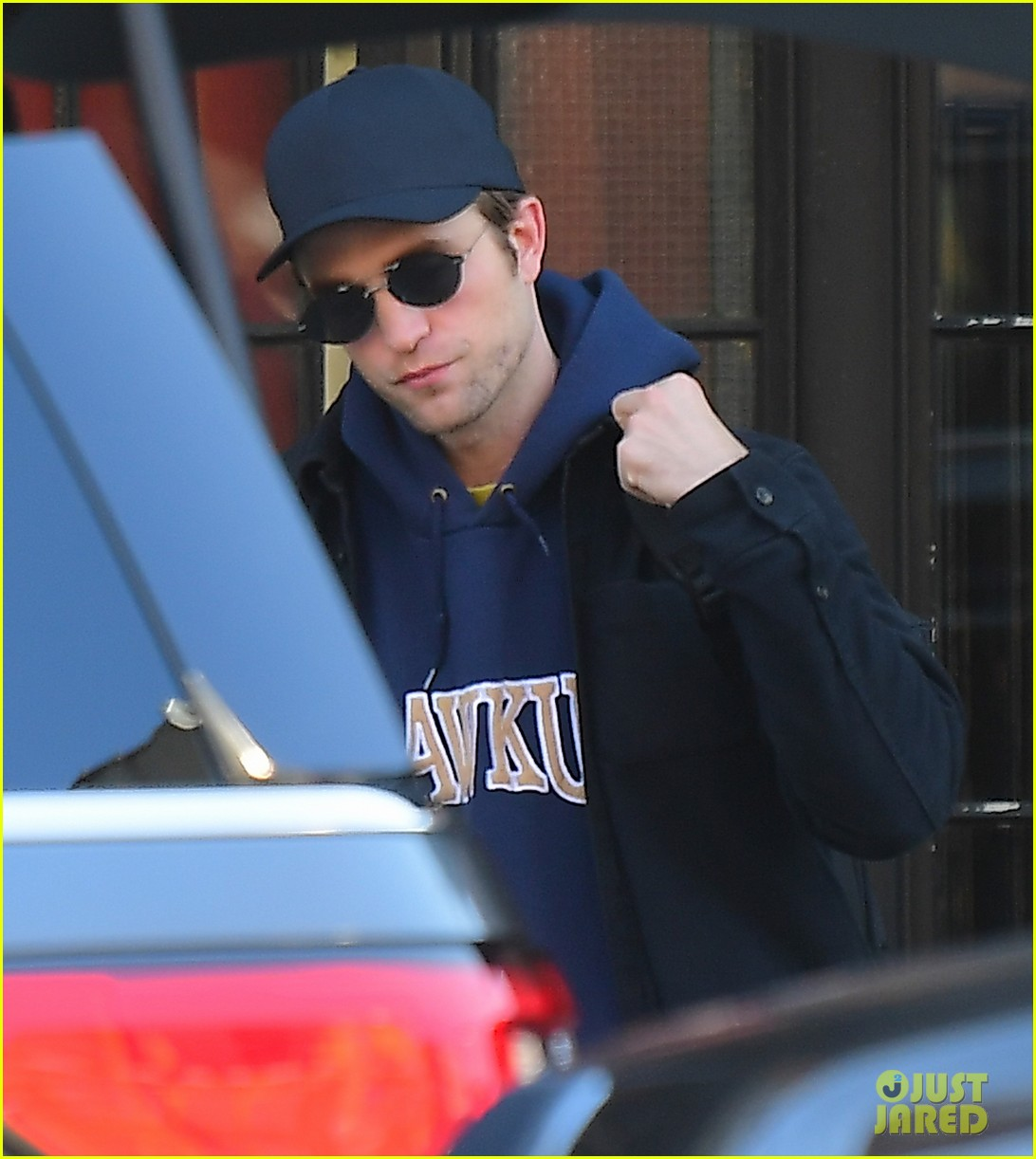 robert pattinson checks out of his hotel in nyc 02