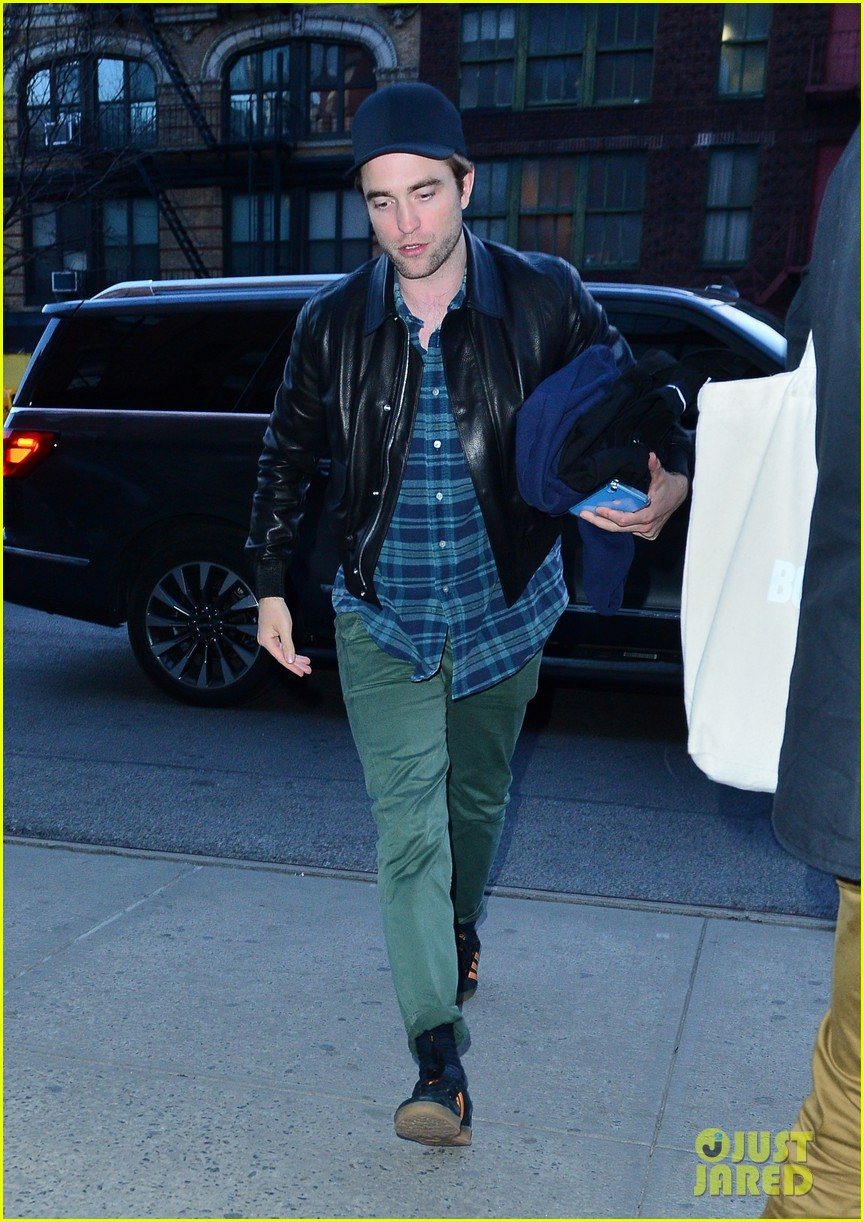 robert pattinson meets up with friends at the movies 05