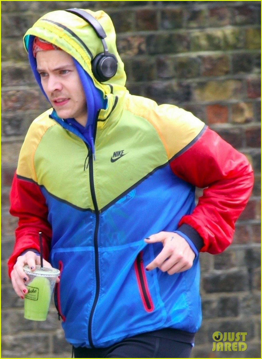 harry styles sports colorful jacket while jogging in london 02