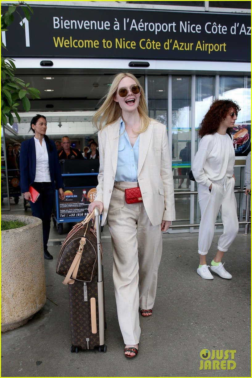 elle fanning makes chic arrival ahead of cannes film festival 014289775