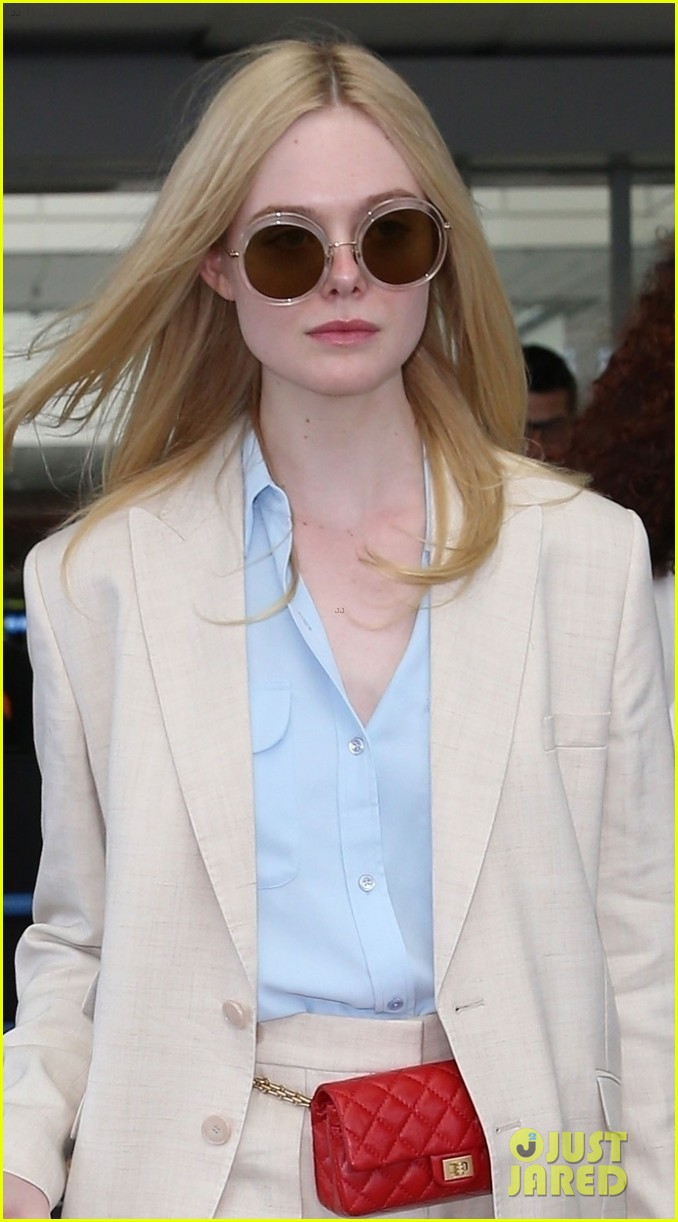 elle fanning makes chic arrival ahead of cannes film festival 024289776