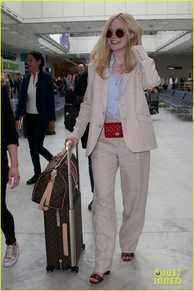 elle fanning makes chic arrival ahead of cannes film festival 034289777