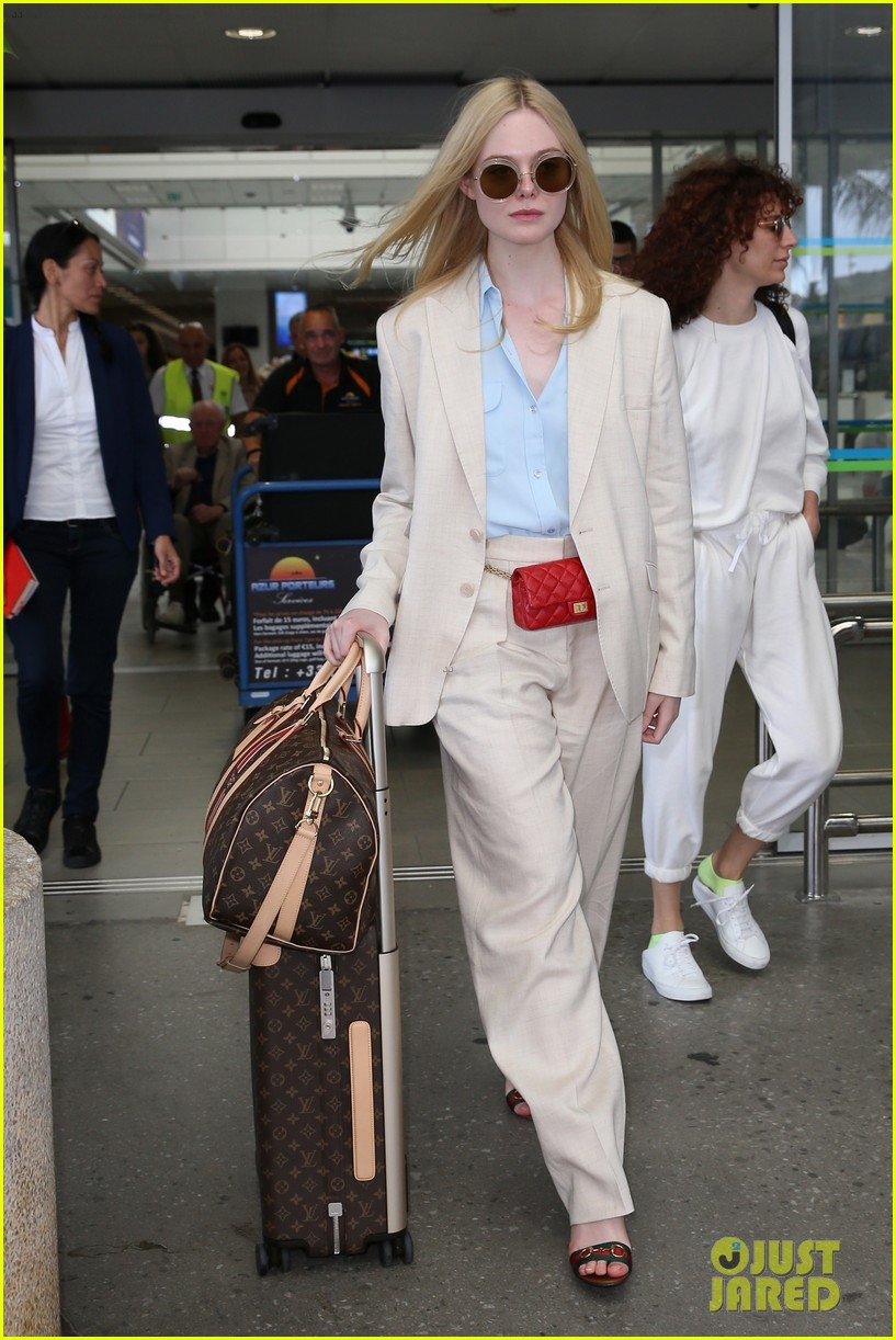 elle fanning makes chic arrival ahead of cannes film festival 054289779