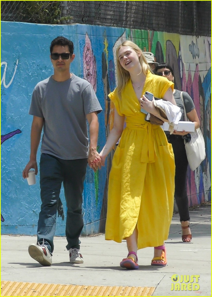 elle fanning holds hands max minghella shopping 054310266