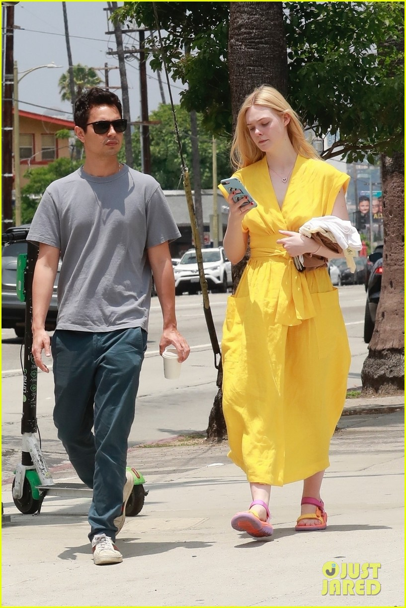 elle fanning holds hands max minghella shopping 064310267