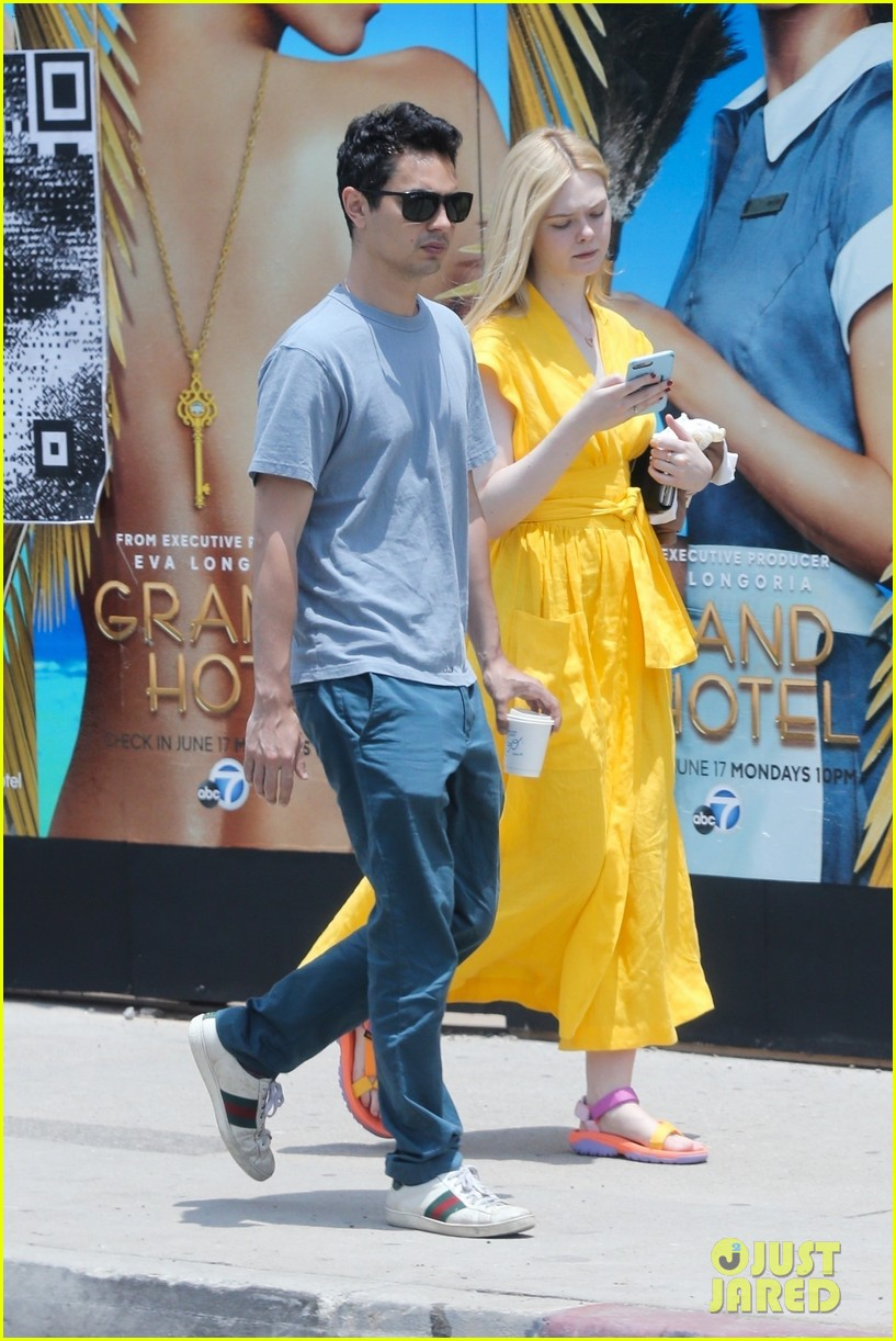 elle fanning holds hands max minghella shopping 084310269