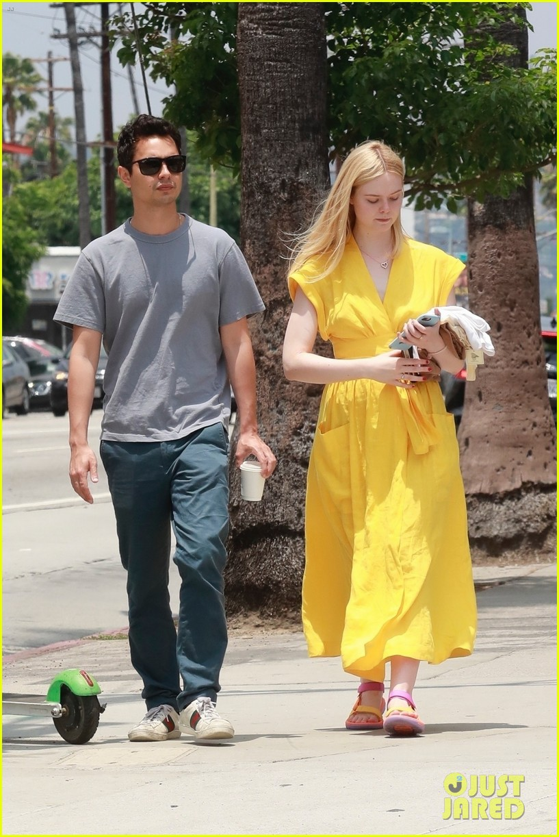 elle fanning holds hands max minghella shopping 094310270