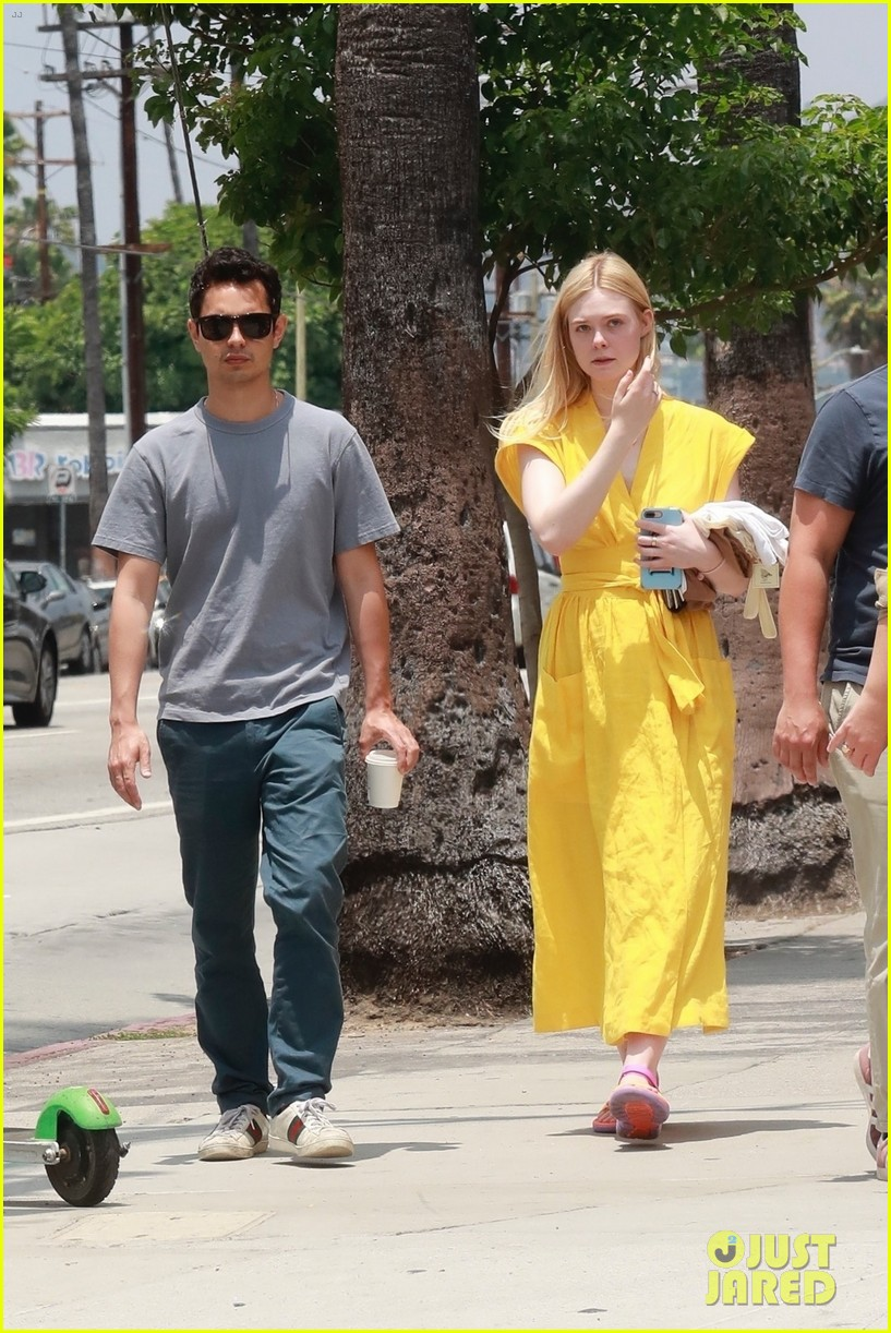 elle fanning holds hands max minghella shopping 104310271