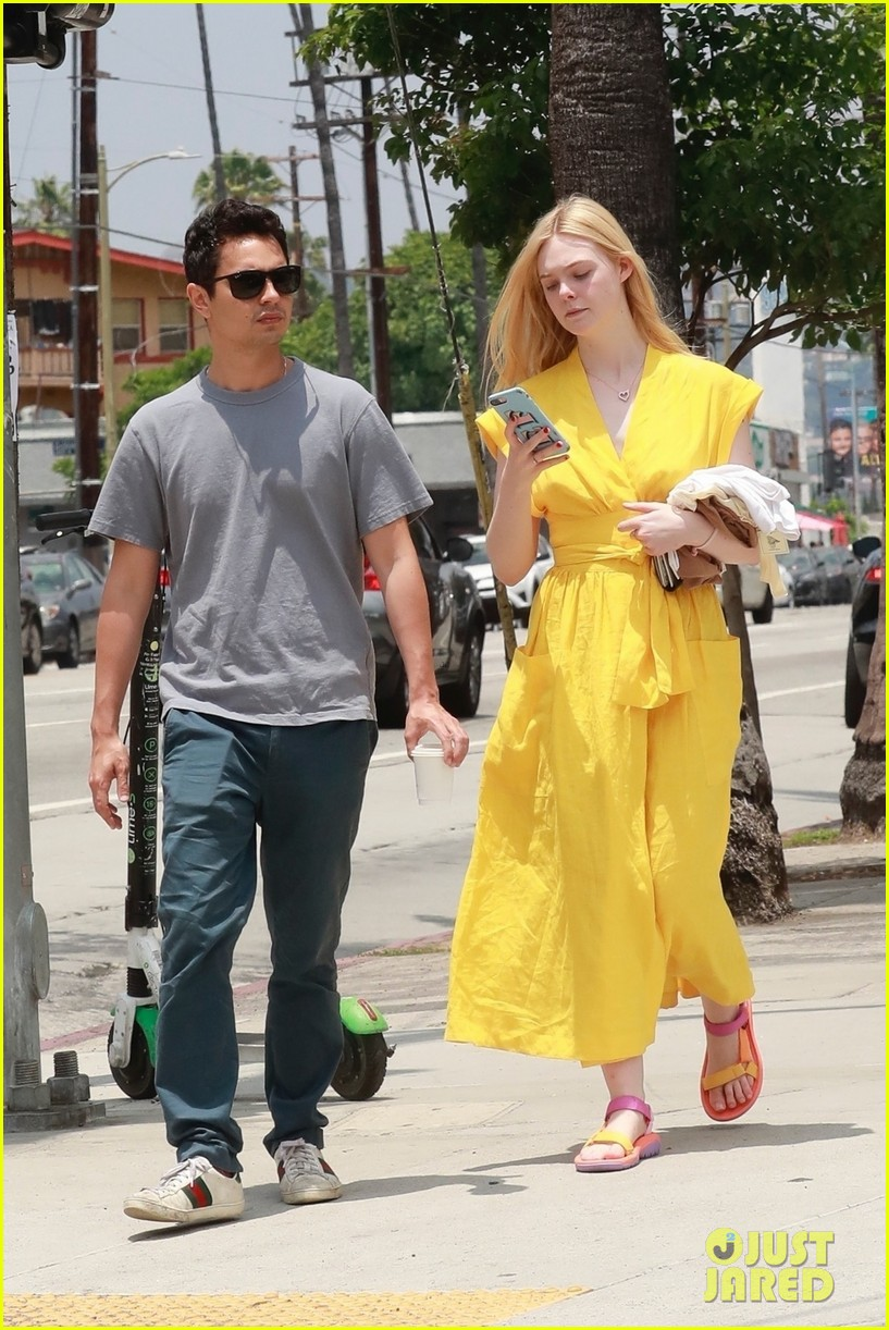 elle fanning holds hands max minghella shopping 124310273