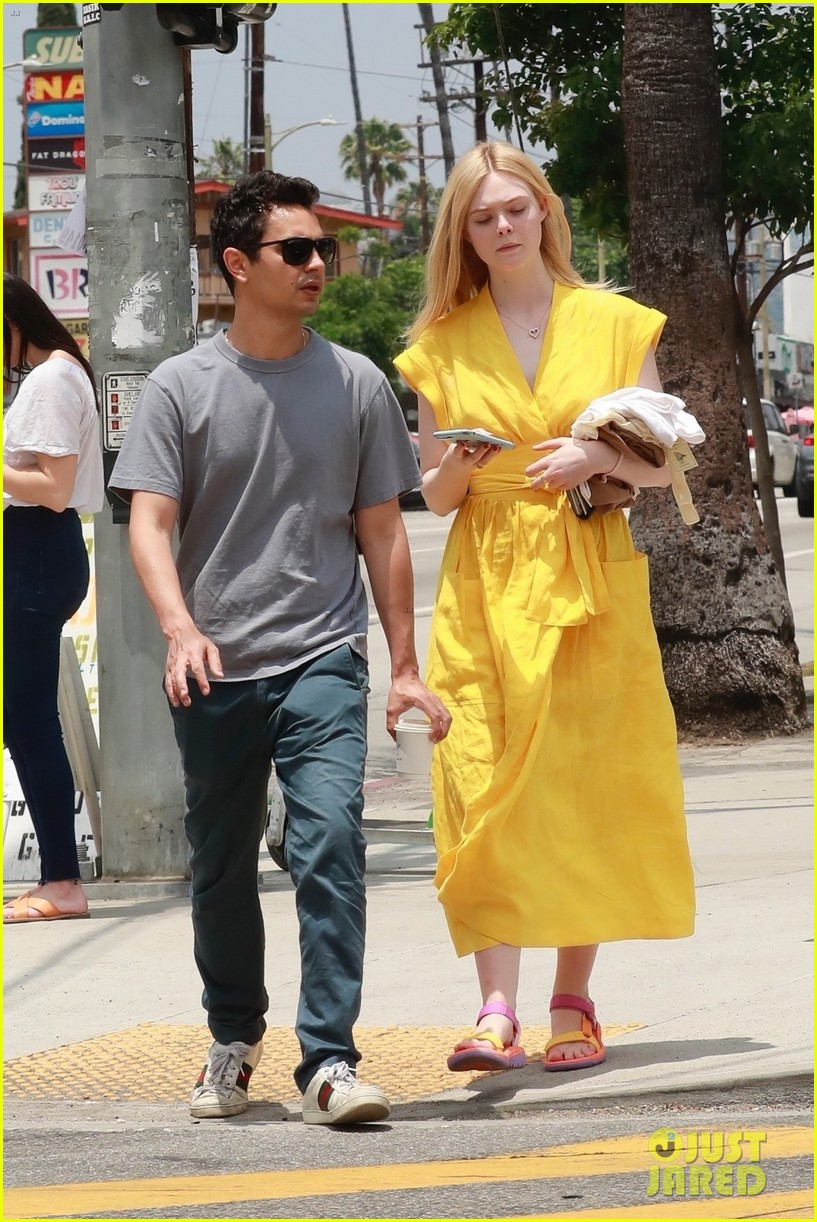 elle fanning holds hands max minghella shopping 134310274