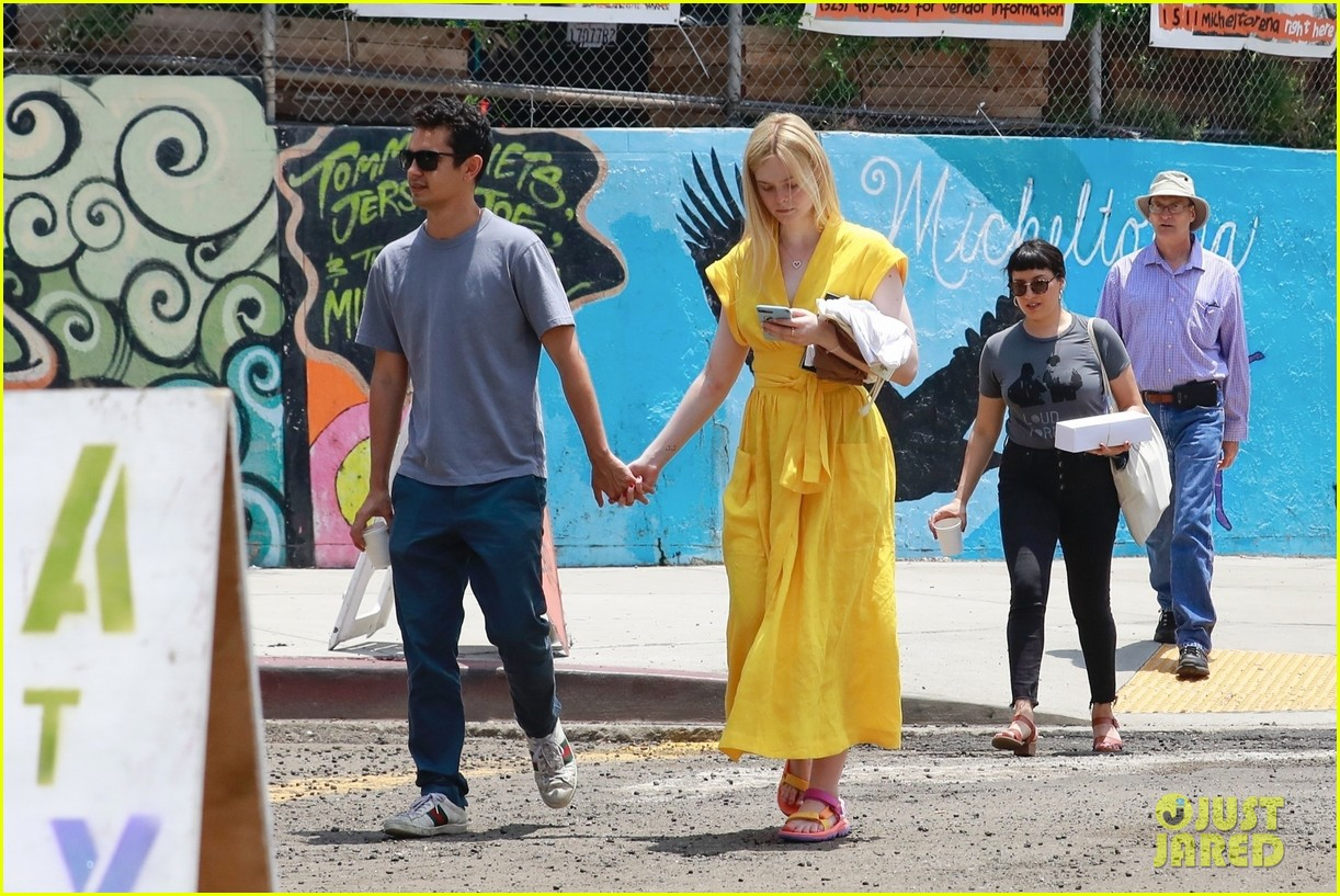 elle fanning holds hands max minghella shopping 154310276