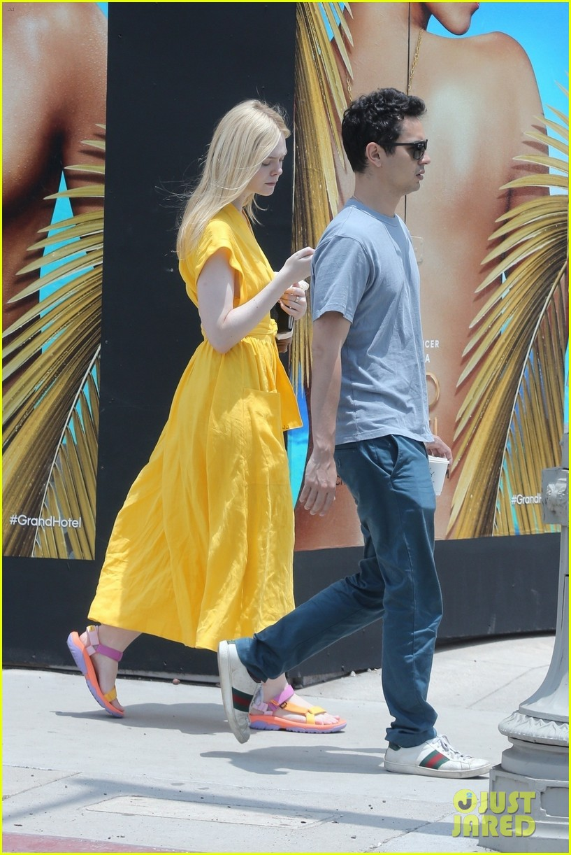 elle fanning holds hands max minghella shopping 234310284