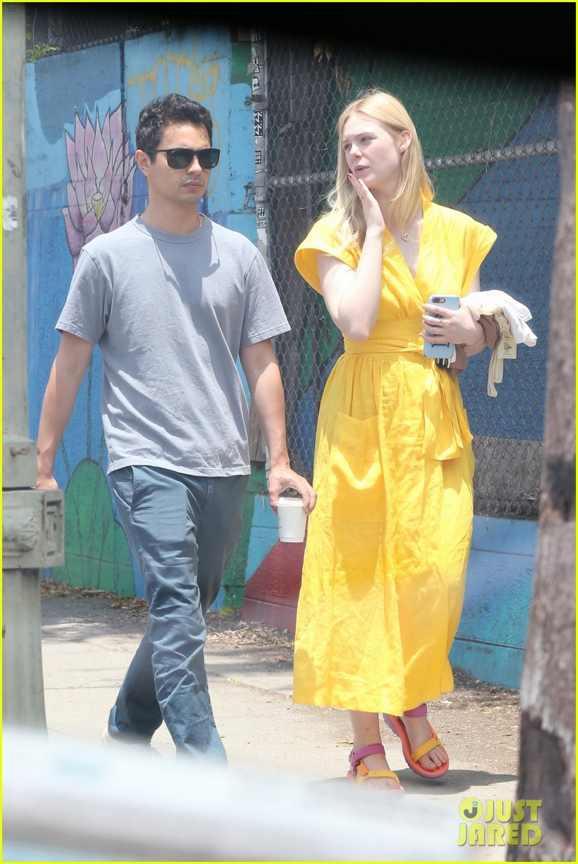 elle fanning holds hands max minghella shopping 264310287