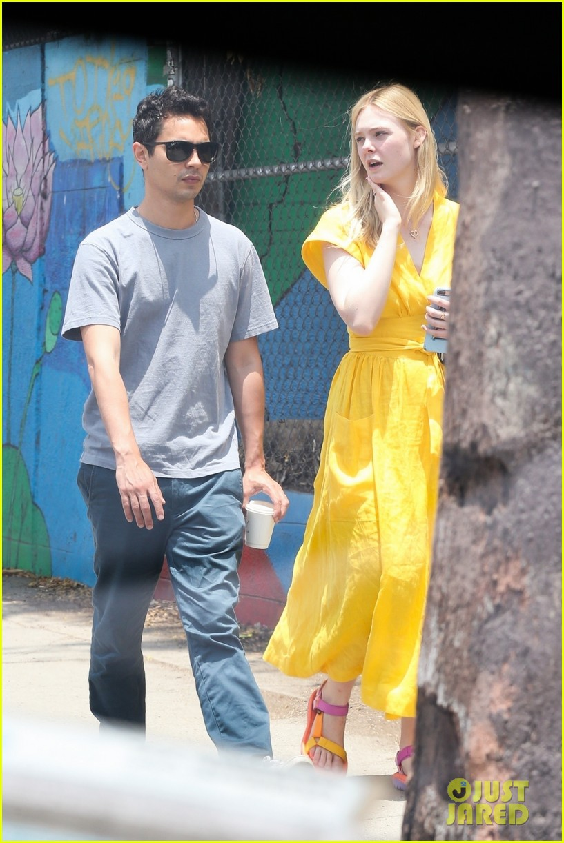 elle fanning holds hands max minghella shopping 274310288